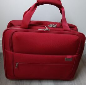 Red Delsey trolley bag