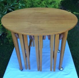 Mid-century Teak coloured veneer nest of tables. Danish retro style. 3 round drop-leaf under oval