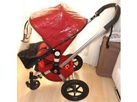 bugaboo frog ,in red with red carrycot and bugaboo raincover ,