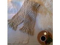 Snuggly knitted beige scarf