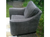 A New Brown Natural Fabric Designer Arm Chair