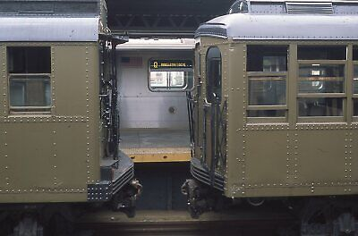 NYCTA slide. Old, oldest, new. 1914 BMT AB, 1925 BMT D-type, R160 subway trains.