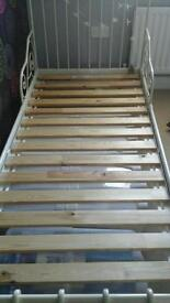 Extendable girls bed with mattress and instructions on assembling.