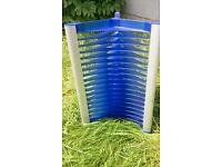 DVD tower storage rack, blue plastic.