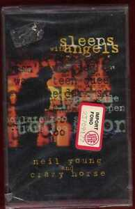 NEIL-YOUNG-AND-CRAZY-HORSE-Sleeps-With-Angels-MC-sigil