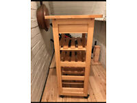 Wooden kitchen trolley with wine racks.