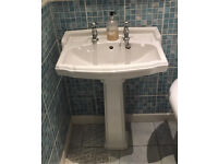 Pedestal basin with chrome taps
