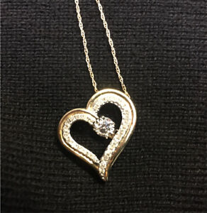 Peoples 0.065 CT. T.W. Diamond Tilted Heart Pendant in 10K Gold