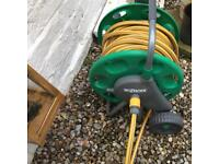 Garden hose hozelock reel on wheels with carry handle and two spay hoses adjustable tap connector
