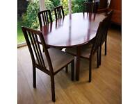Morris of Glasgow extendable dining table with six chairs.