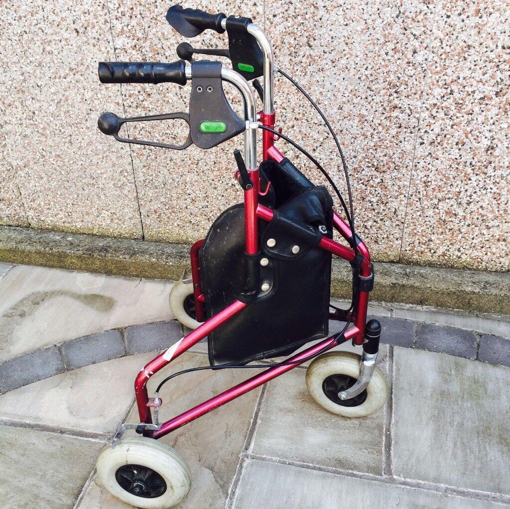Three wheel walker with shoping bag