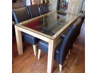 Glass and oak dining table and 6 chairs