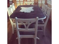 Stunning rustic solid wood extending table and 8 chairs
