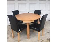 Brand New Circular Dining Table & 4 Black Faux Leather Dining Chairs