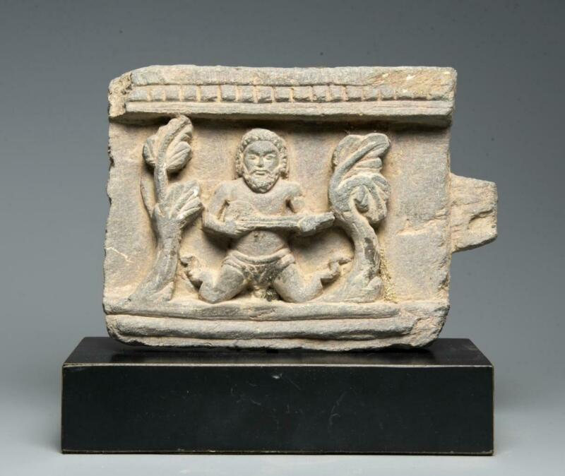 Gandharan stone panel with musician: 4th century AD.
