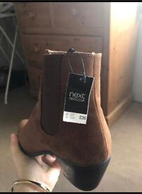 Brand new boots (tag still on)