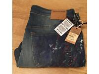 Brand new with tags authentic hand painted men's True Religion jeans. Waist 34.
