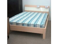 Teak effect wooden double bed (does not include mattress)