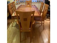 Expensive veneer wood dining table 6 seater with 6 hard wood chairs in Golders Green