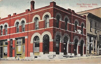 Butler Ohio~First National Bank Corner~Store on Street Uphill~1912 Postcard ()