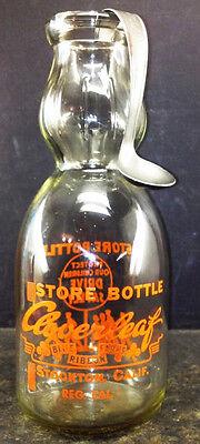 A Quart Creamtop Milk Bottle with Dated Cream Spoon