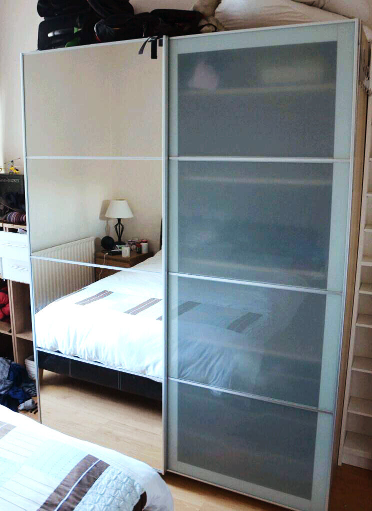 Beautiful IKEA Pax wardrobe sliding doors mirror glass wire baskets ...