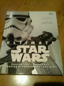 Starwars ultimate hardback book with two exclusive prints.