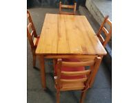 Dining table with 4 chairs and cushions