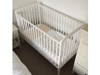 White cot with mattress and duvet