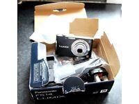 Panasonic Lumix FS14 camera with Leica lens.