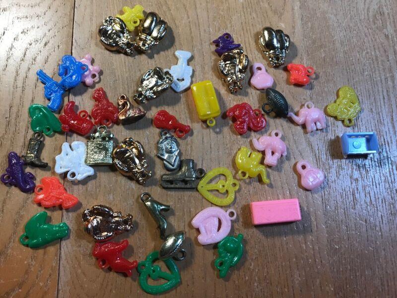 Lot of 45 CHARMS Vintage Miniature Plastic Gum ball Machine Prizes Toys
