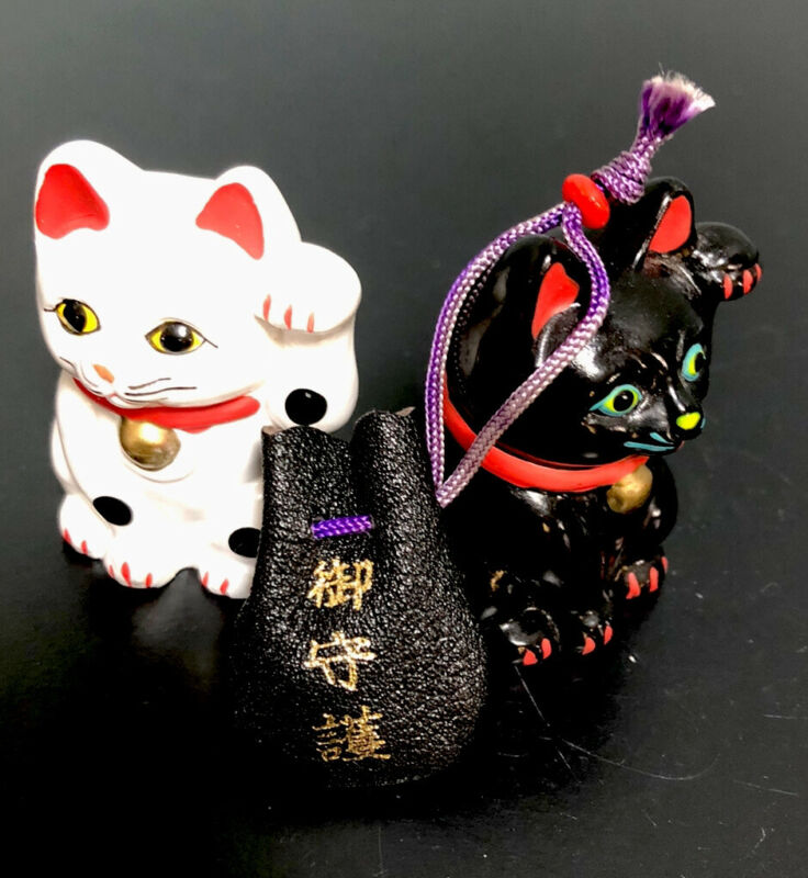 Maneki-Neko Lucky Cats Japanese Ceramic. Black Bag Carrying Lucky Charms.