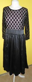 Kaleidoscope Black 3/4 Dress with black skirt and spotted bodice. Sizes: 10, 12, 14, and 16.