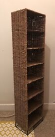 Rattan storage shelves can take cds tall and slim lovely condition
