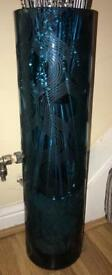 Very large teal glass vase & reeds