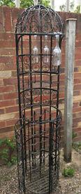 Attractive, free standing wrought iron wine rack / bar