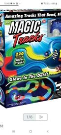 Light up racing track and ring toss