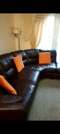 Two part beautiful brown leather sofa