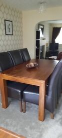 Dark wood dining table, with 6 chairs