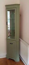 Sage green corner cabinet