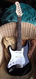 LEFT HANDED STAGG 3/4 SIZE STRAT COPY IN BLACK GLOSS. GOOD CONDITION AND SET UP READY TO GO
