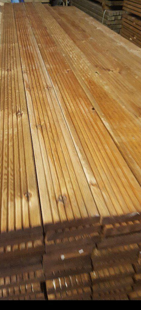 Brown Pressure Treated Decking boards.