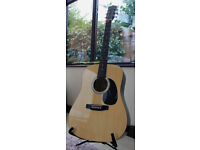 Fender Squier SA105 Acoustic Guitar with accessories.