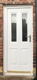 White UPVC Rockdoor with 2 xfrosted double glazed panels, ideal kitchen door.