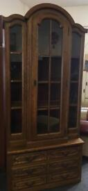 Tall glass fronted book case can deliver