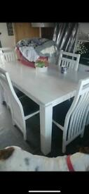 White and black table and chairs