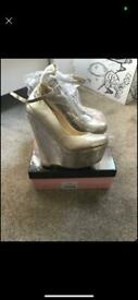 Women's gold wedges size 7