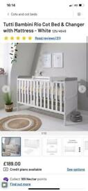 Cot / cot bed with mattress and changing table.