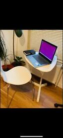 Adjustable laptop table with a chair for sale.