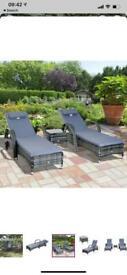 Sun loungers and table rattan garden furniture